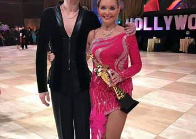 Misha and Natalie proudly holding a trophy